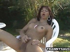Latina shemale stunner stroking on her cock outdoors
