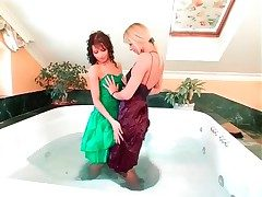 Girls upon magnificent dresses have a bath together
